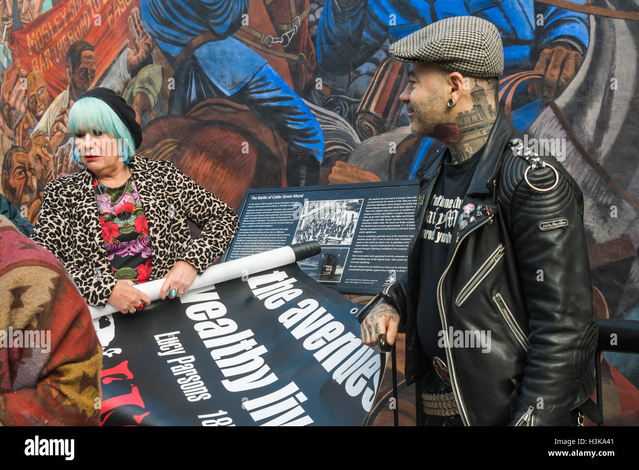 London, UK. 9th October 2016. Jane Nicholl of Class War rolls up the banner at the end of their rally in front of - Stock Image
