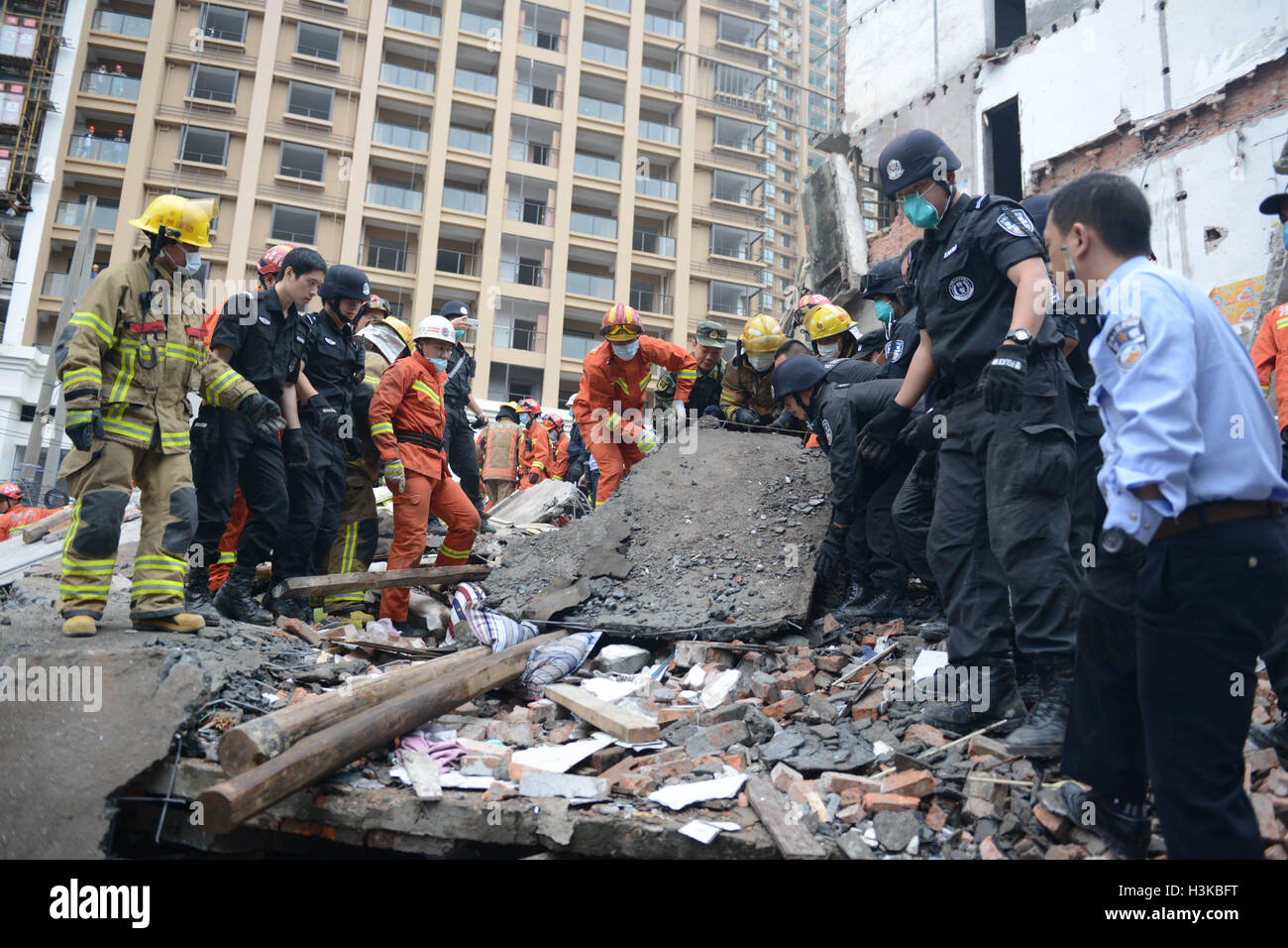 Wenzhou. 10th Oct, 2016. Rescuers search for survivors at the accident site after four residential houses collapsed Stock Photo