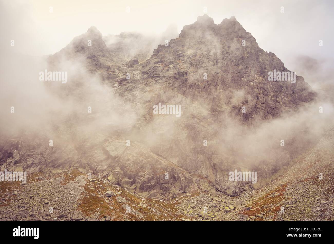 Cloudy mountain landscape. Rocky peaks in the clouds in High Tatra, Slovakia. - Stock Image