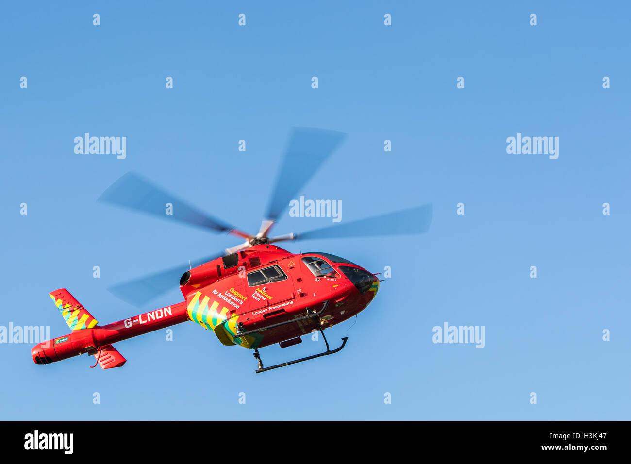London Air Ambulance Helicopter attending an emergency in Shepherds Bush London UK - Stock Image