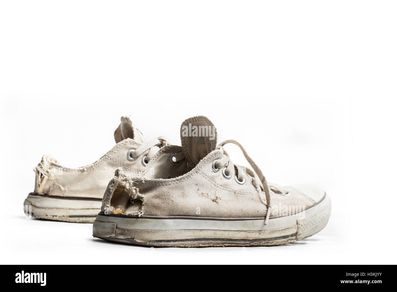 old sneakers isolated on white - Stock Image