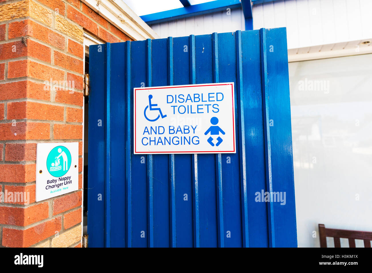 Disabled toilets sign baby changing toilets sign signs baby nappy changer unit sign GB UK England - Stock Image