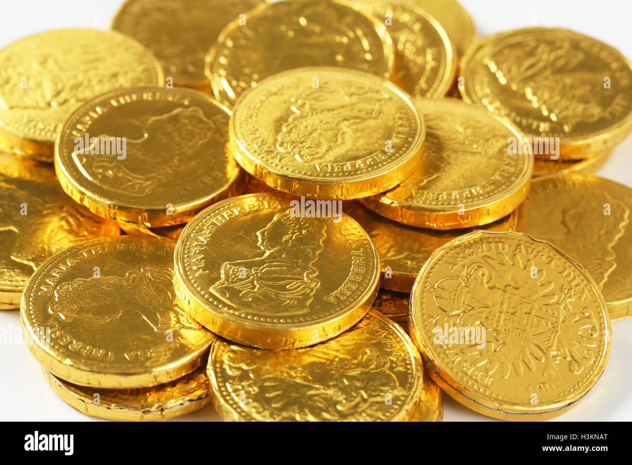 Chocolate money stock photos chocolate money stock images alamy detail of golden chocolate coins pile stock image spiritdancerdesigns Image collections