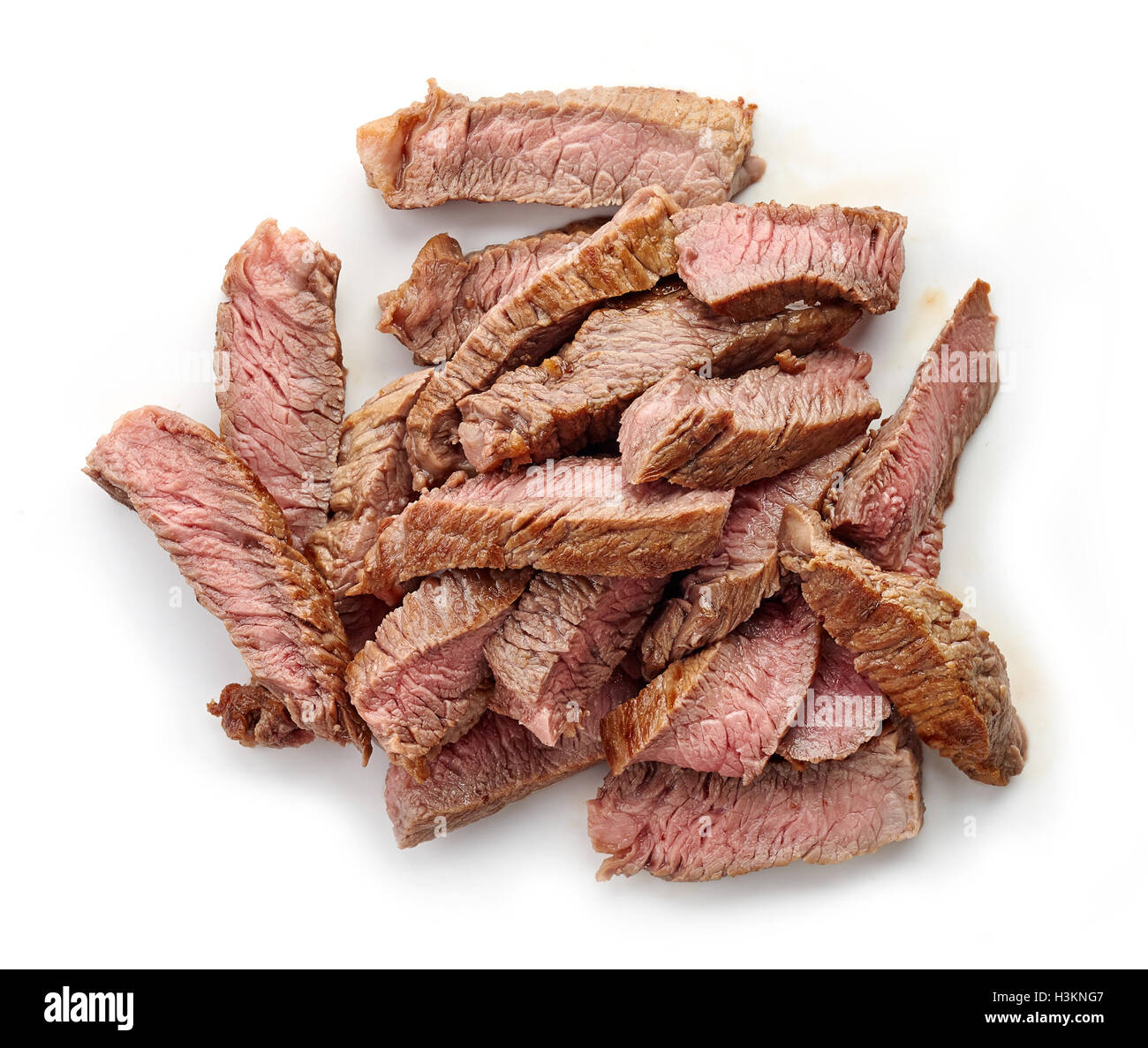 Bowl of grilled beef slices isolated on white background, top view - Stock Image