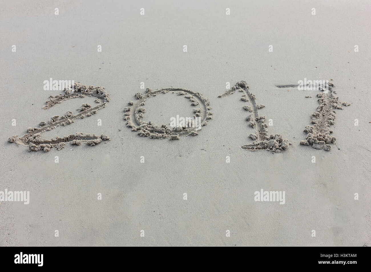 digits of the year on the sand songkhla thailand - Stock Image