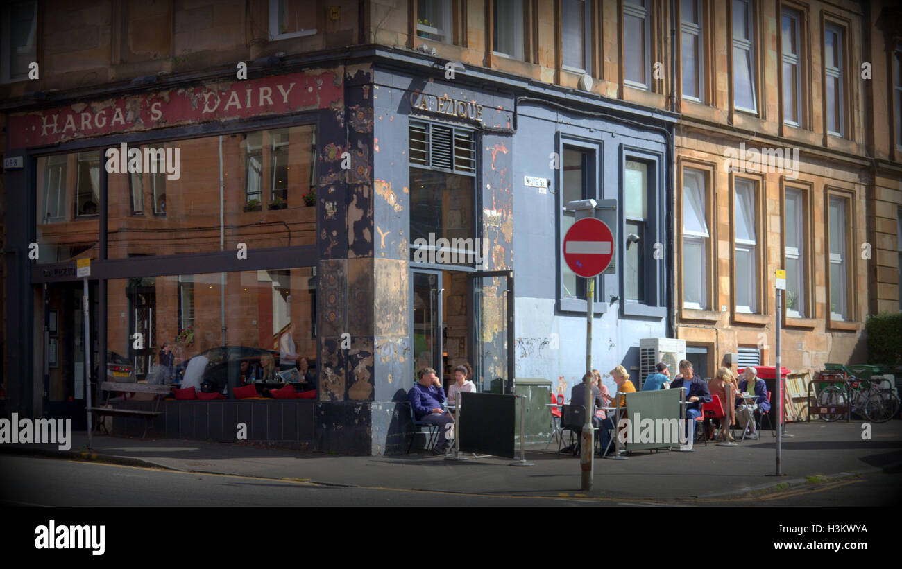 Glasgow tourist travelers visiting the city Harga's Dairy cafe scene White Street  partick - Stock Image