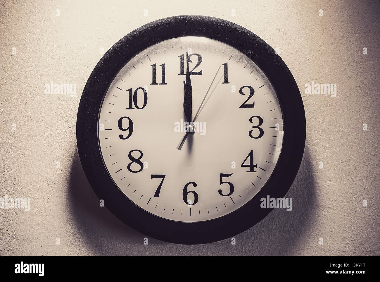 Details of a dusty clock on the white wall, retro style. - Stock Image