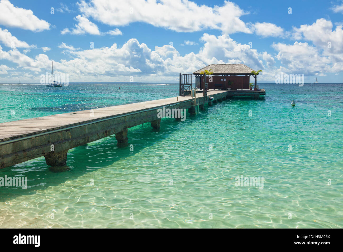 Jetty at tropical beach, Guadeloupe Stock Photo