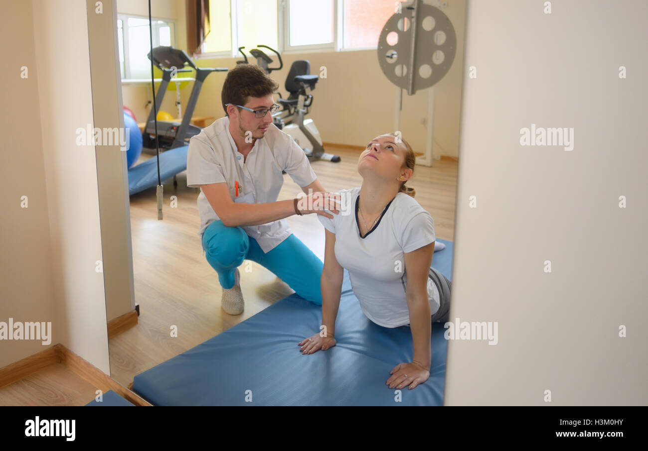 elongation treatment of low back pains with instructor - Stock Image