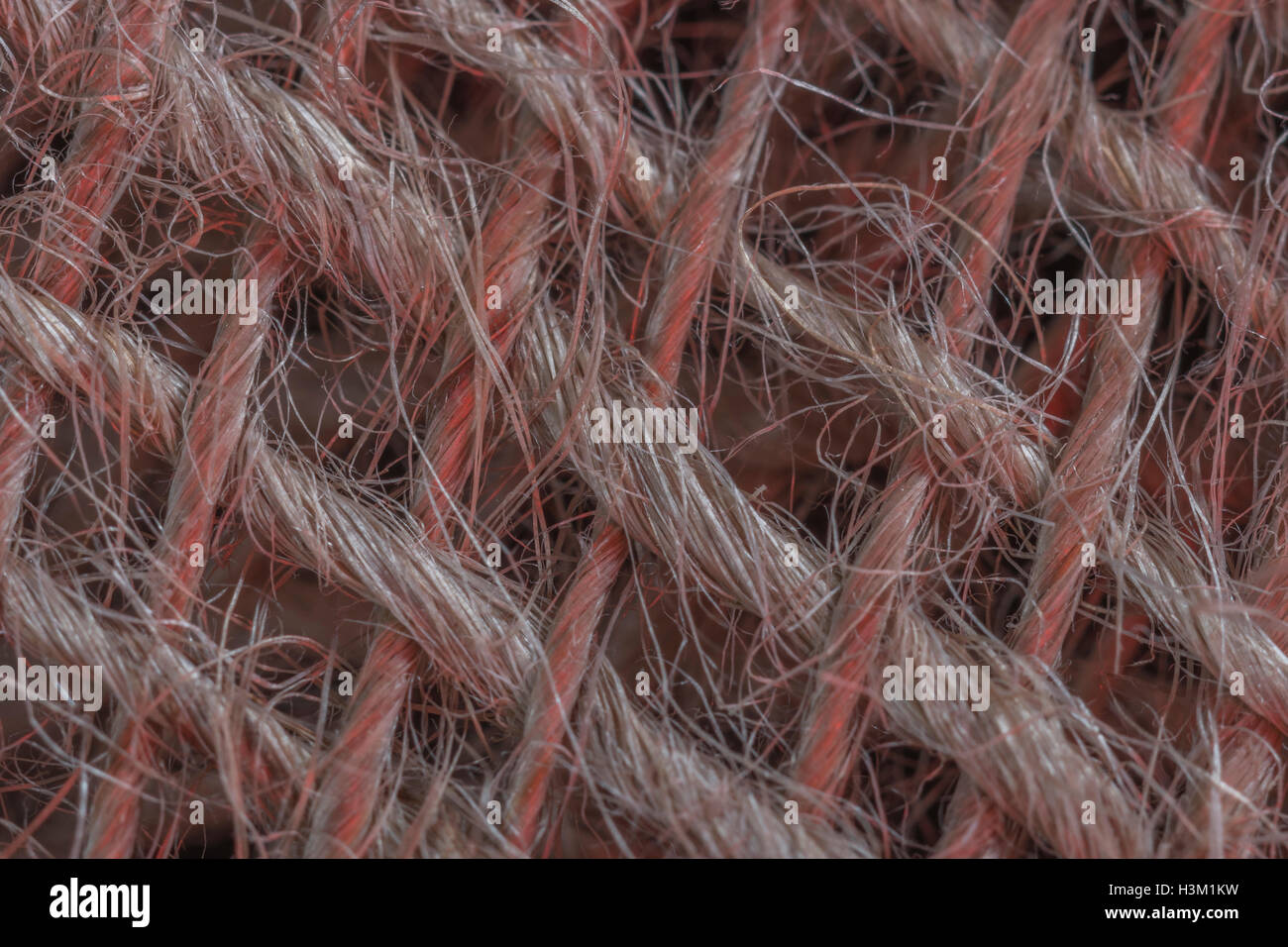 Macro-photo of natural fibre, jute burlap sacking material showing detail of the fine threads. - Stock Image