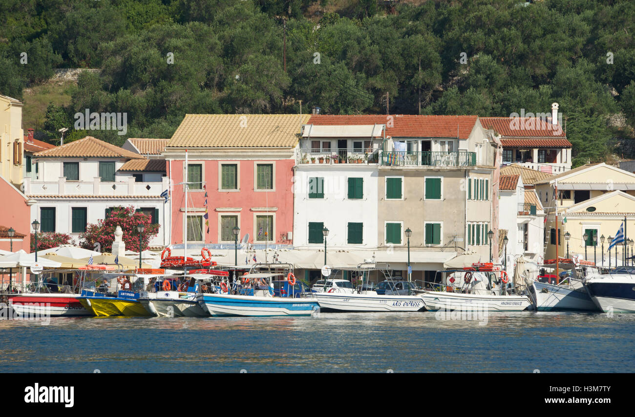 Colourful waterfront buildings Gaios port Paxos Ionian Islands Greece - Stock Image
