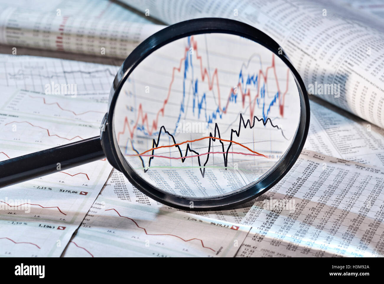 Magnifier shows the variation of stock prices, - Stock Image