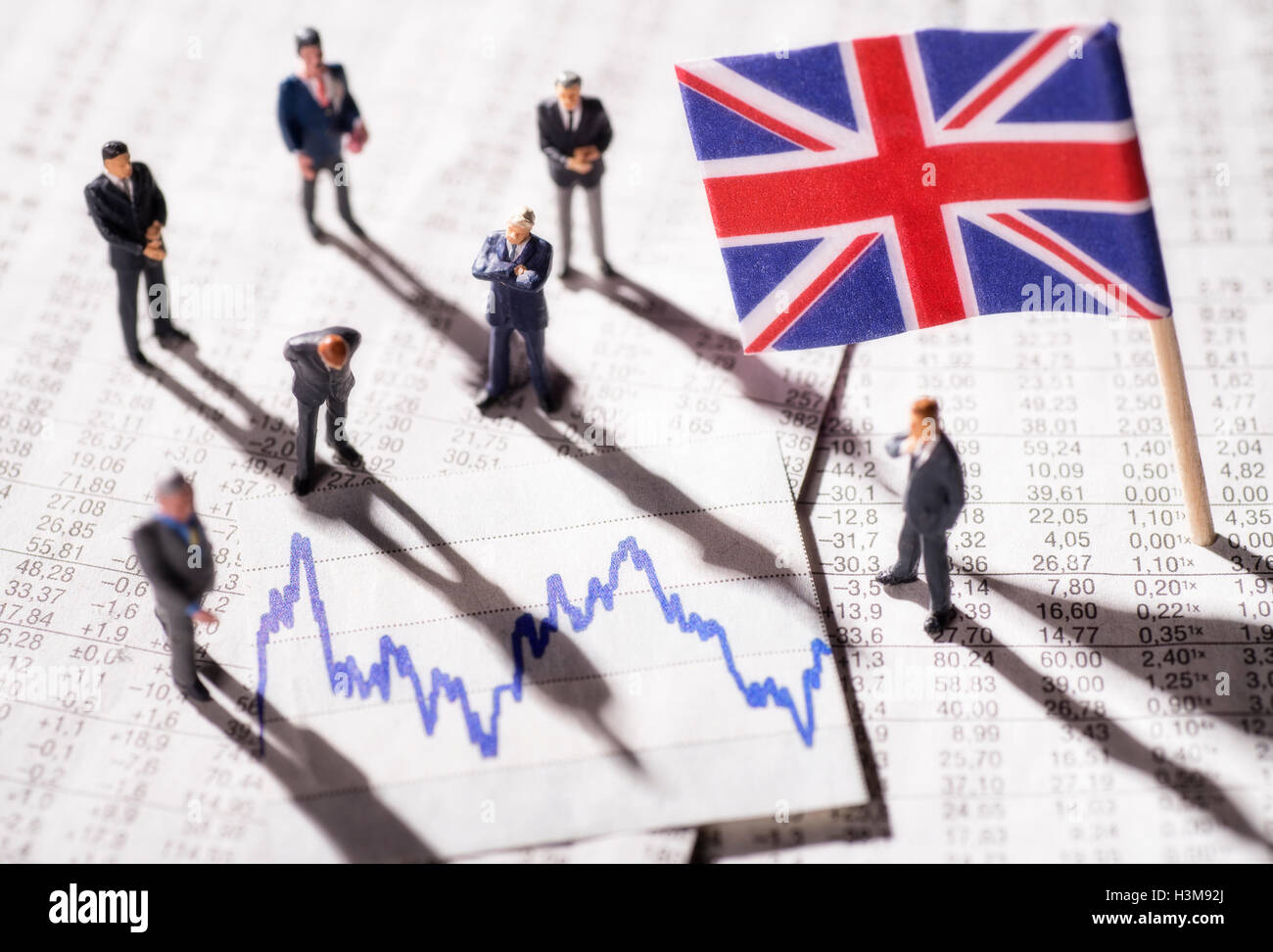 Manager with chart and the flag of Great Britain - Stock Image