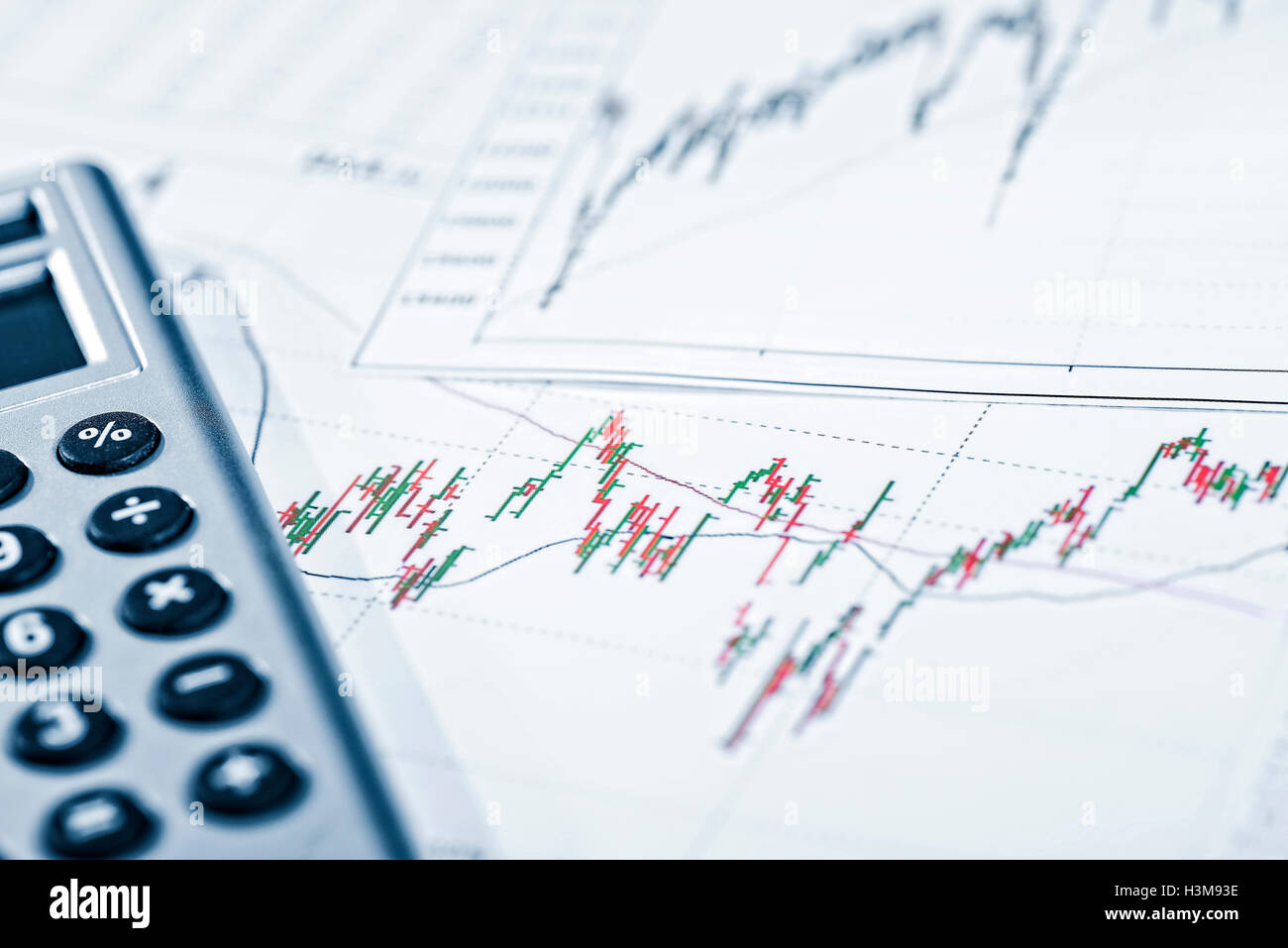 Charts with price development and a calculator - Stock Image