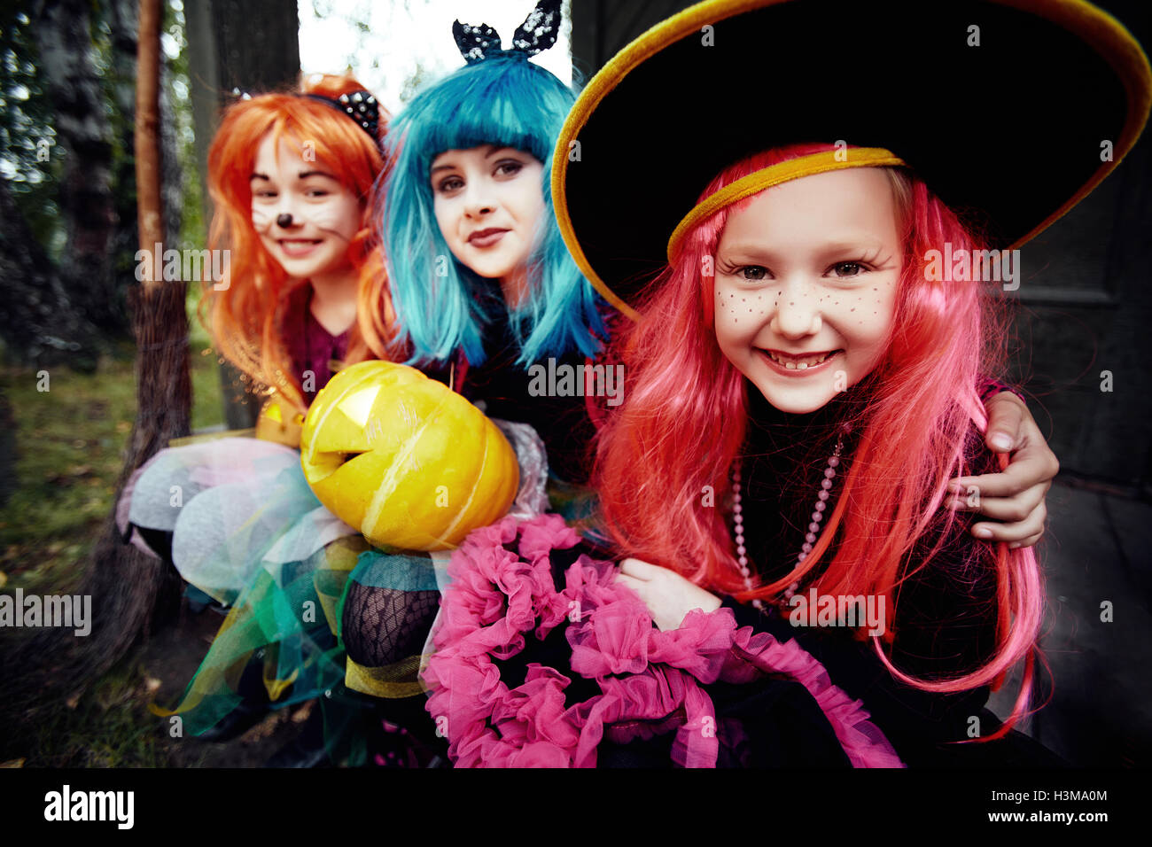 Adorable Girls In Halloween Costumes Looking At Camera