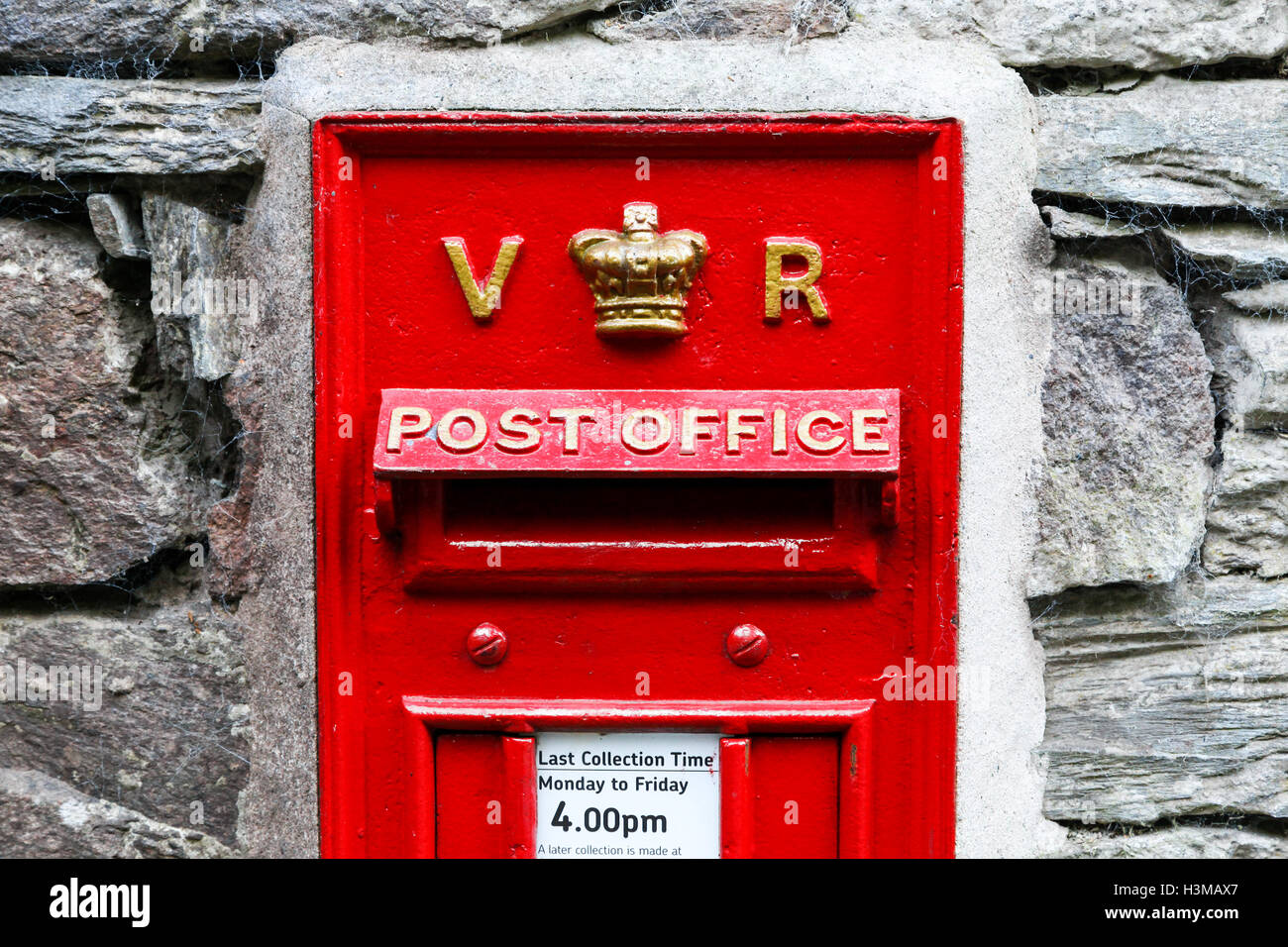 A Victorian red letter box, post box or mail box - Stock Image