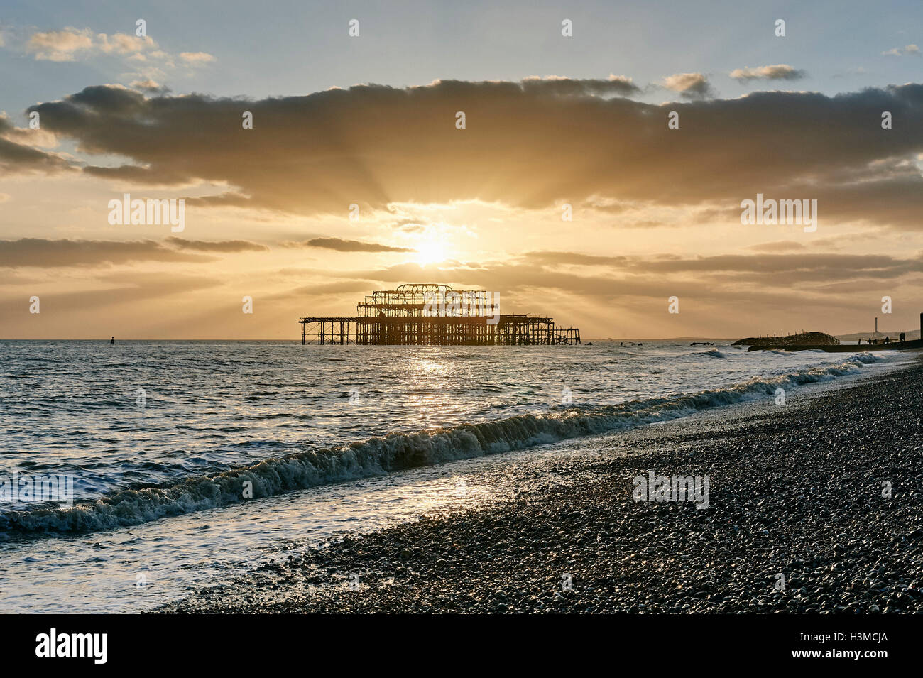 Brighton beach at sunset, England - Stock Image