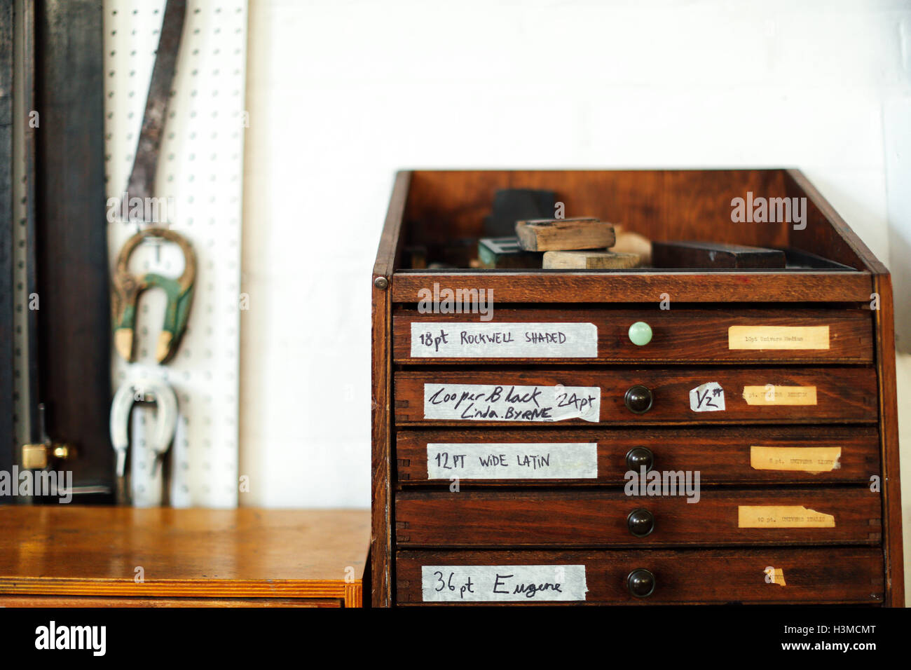Still life of wooden drawers and equipment in print workshop - Stock Image