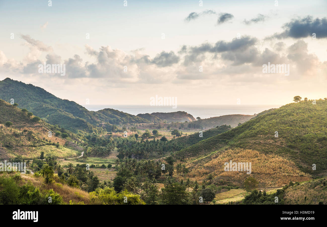 Elevated landscape and distant sea, Mawi Beach, Lombok, Indonesia - Stock Image