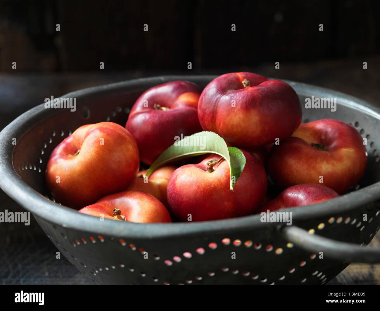 Fresh organic fruit, donut nectarines - Stock Image