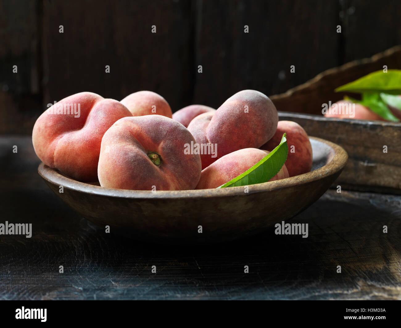 Fresh organic fruit, donut peaches - Stock Image
