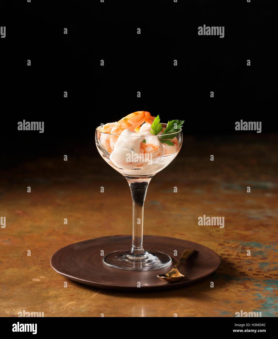 Posh prawn cocktail in wine glass with coriander - Stock Image