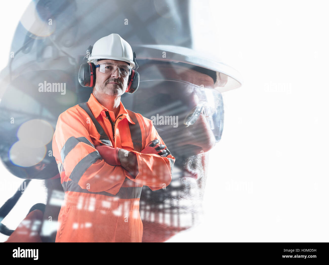 Composite image of construction worker showing full health and safety wear - Stock Image