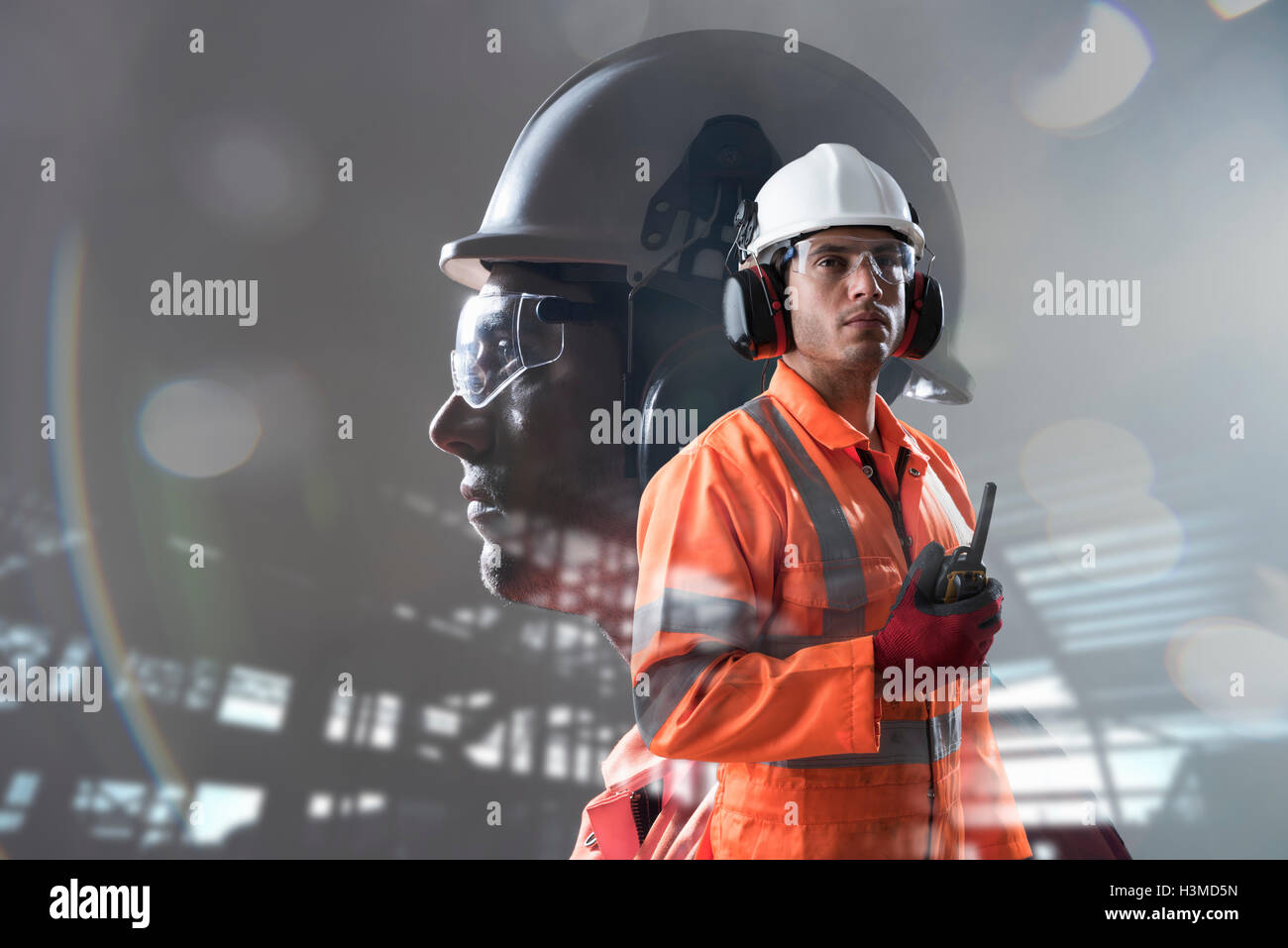 Composite image of construction worker showing full health and safety wear Stock Photo