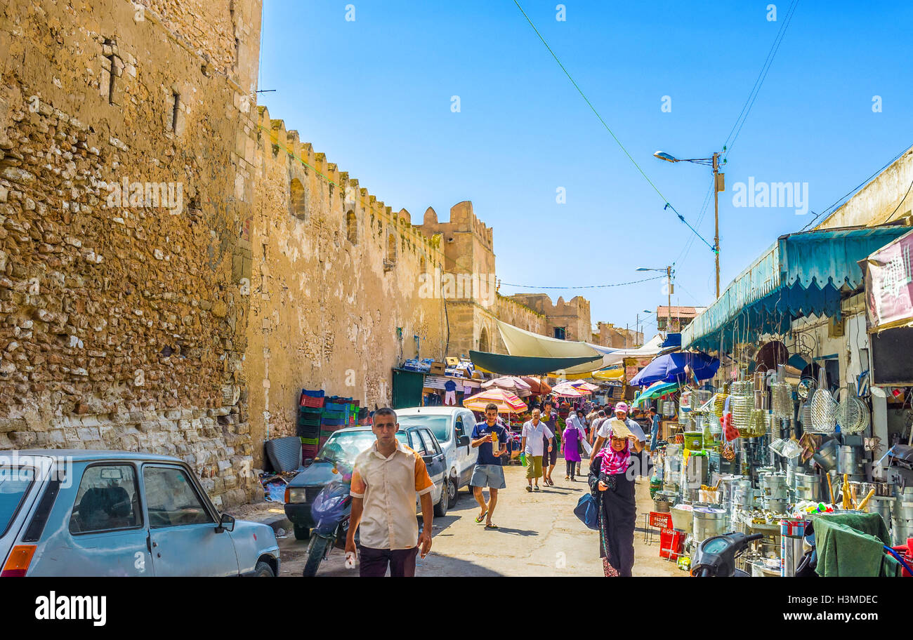 The half of all Medina walls in town surrounded by the outdoor market in Sfax - Stock Image