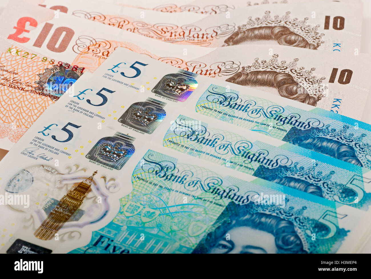 New polymer five pound notes and paper ten pound notes England UK United Kingdom GB Great Britain - Stock Image