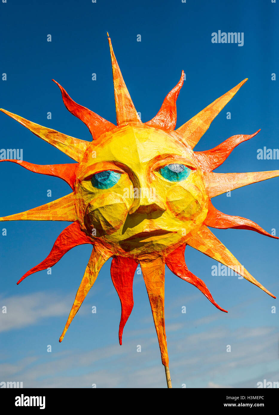 A papier mache representation of the sun in the Penryn Festival in Cornwall - Stock Image