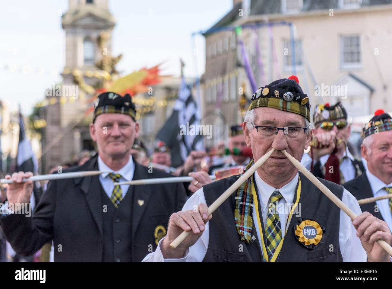 A drummer of the Falmouth Marine Band takes part in the Penryn Festival in Cornwall - Stock Image