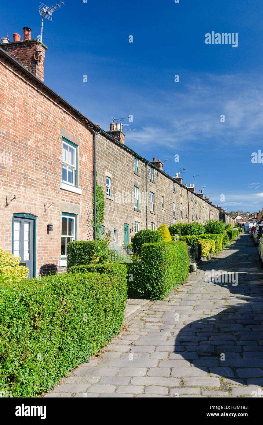 Stone houses in Long Row, Belper which were built by the Strutt family for workers at the cotton mills - Stock Image