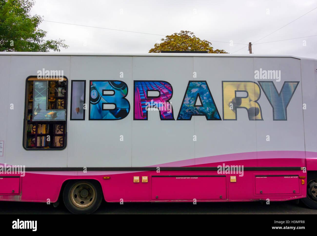 Artistic wording on side of mobile library van Milton Cambridge Cambridgeshire England 2016 - Stock Image