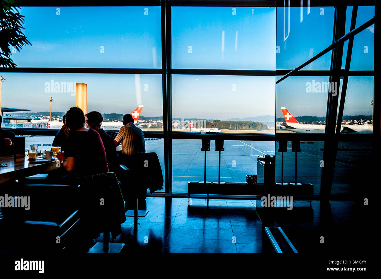 High contrast view of Zurich Airport terminal cafe window, Switzerland - Stock Image