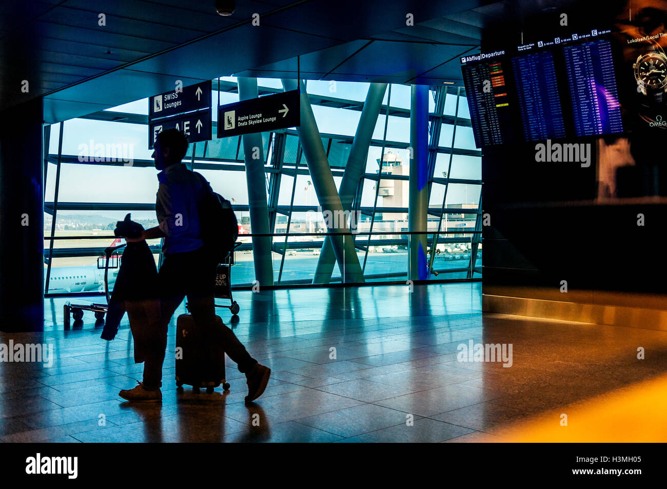 High contrast view of Zurich Airport terminal businessman, Switzerland - Stock Image
