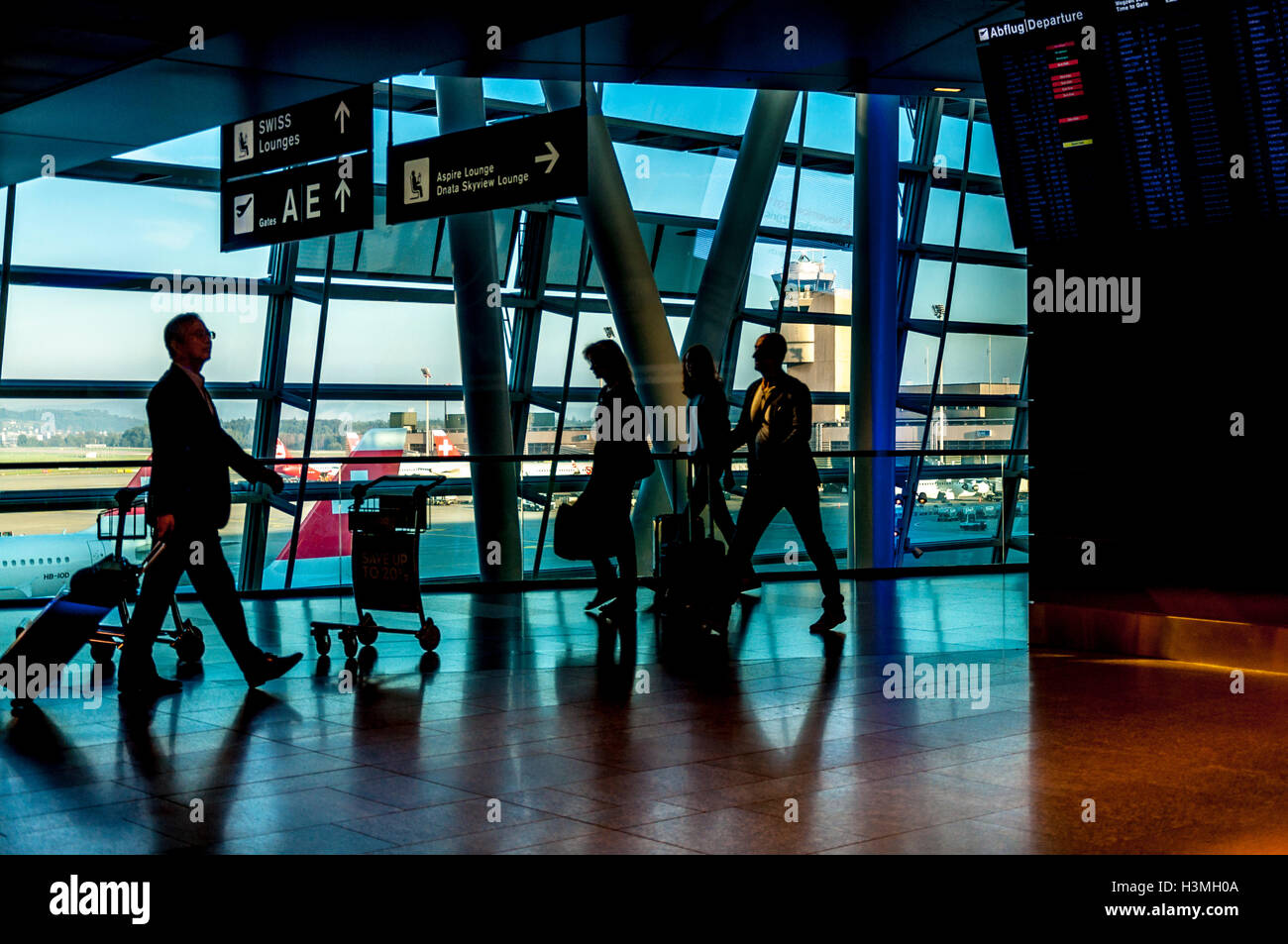 High contrast view of Zurich Airport terminal passengers, Switzerland - Stock Image