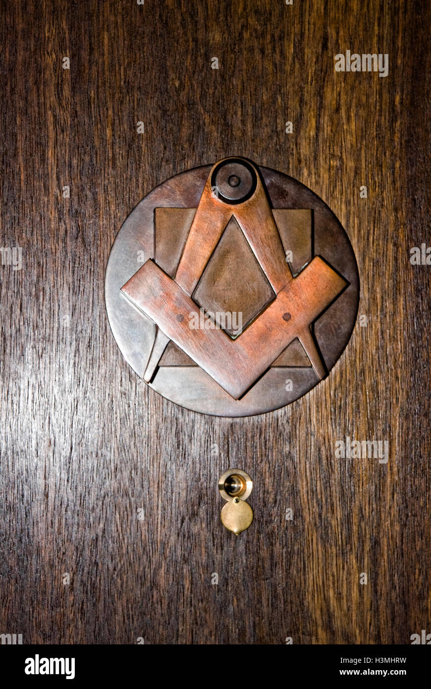 brass door knocker masonic symbols compass  square inside a masonic lodge freemason freemasonry freemason secret - Stock Image