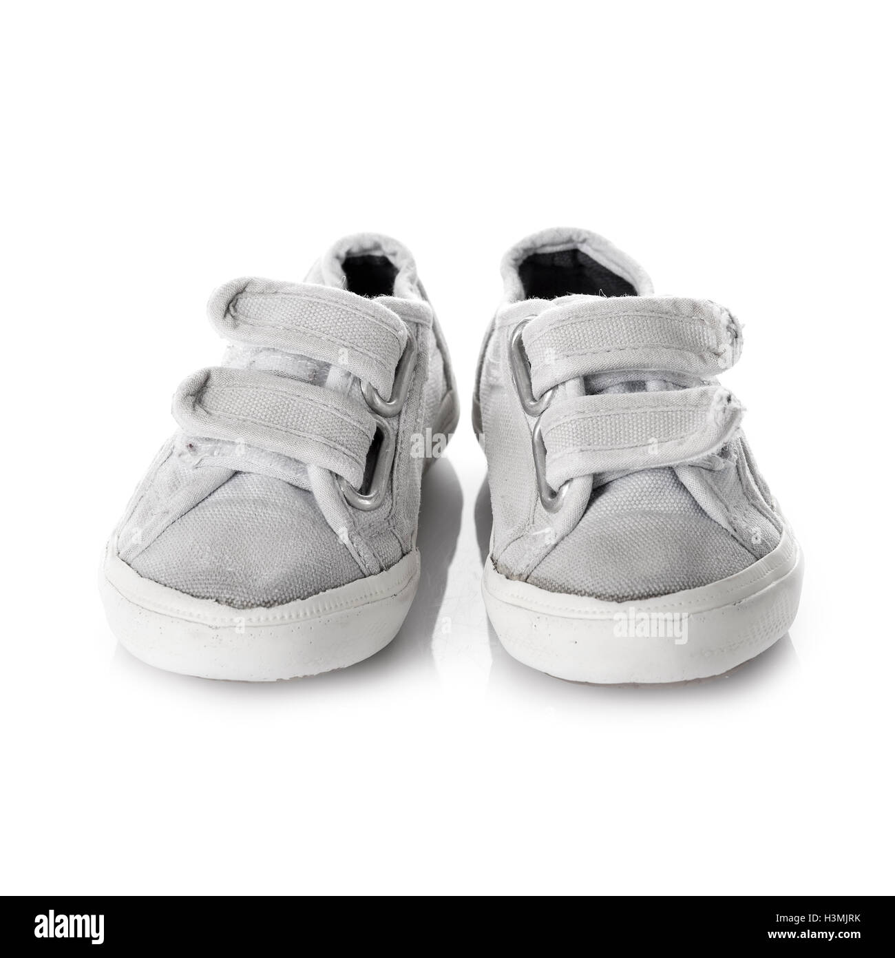 Sneakers shoes for kids with velcro fastening isolated on white background - Stock Image