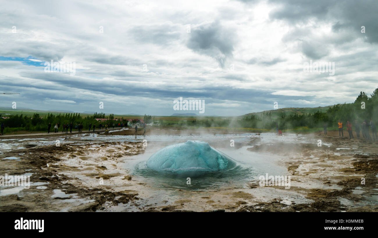 View of Geyser Strokkur about to erupt in Iceland - Stock Image