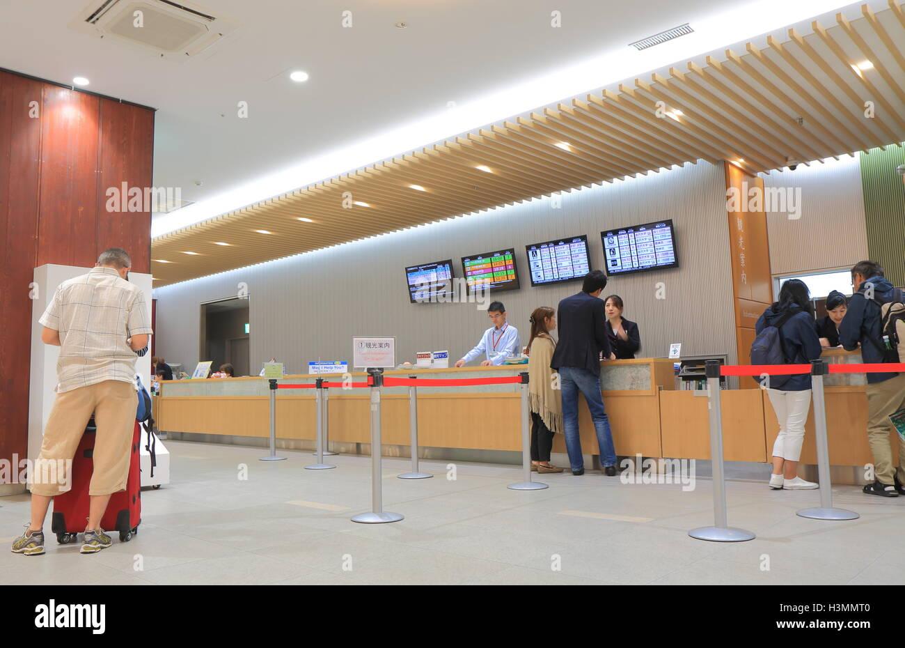 People visit tourist information centre at Kanazawa train station in Kanazawa Japan - Stock Image