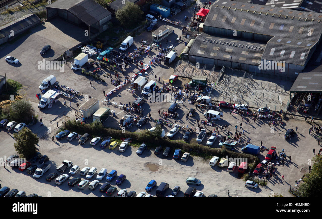 aerial view of people gathered for a Sunday morning car boot sale in Cheshire, UK - Stock Image