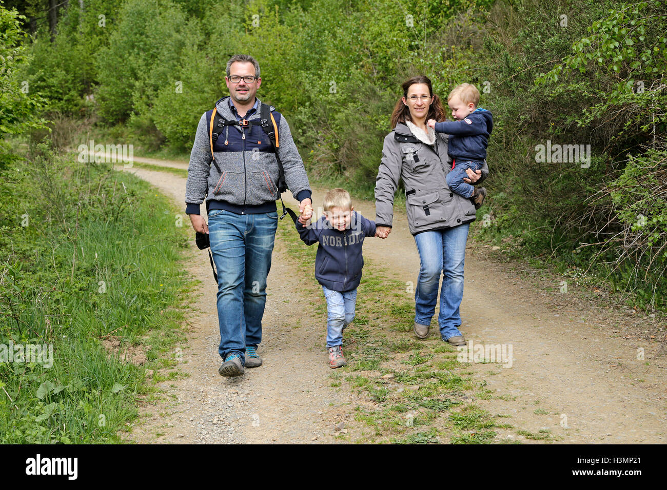 young family going for walk in the woods - Stock Image