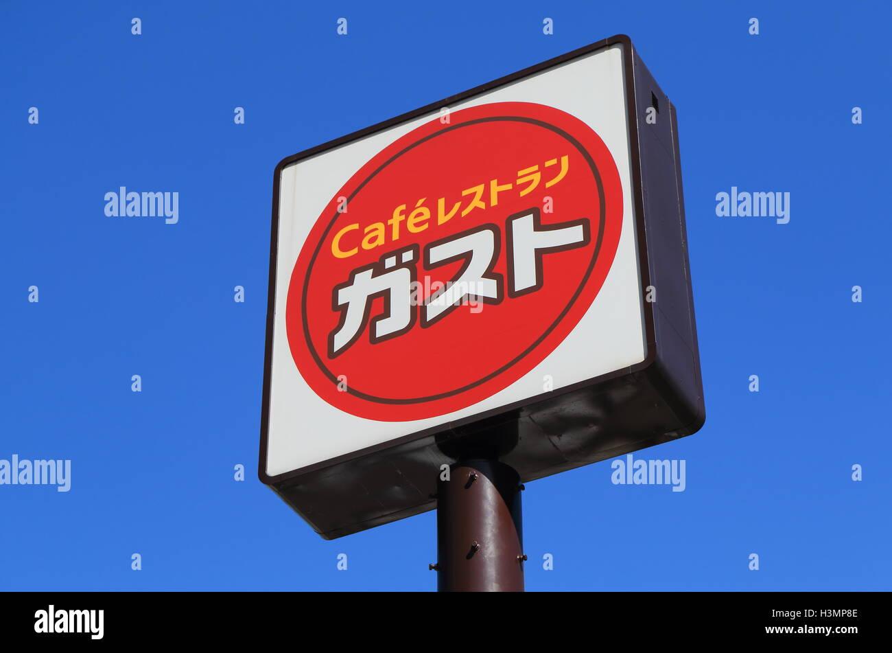 Japanese family restaurant Gusto sign. - Stock Image