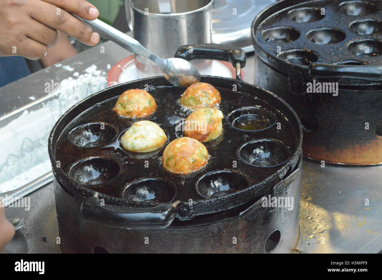 A local street food joint  in a market in bangalore india - Stock Image