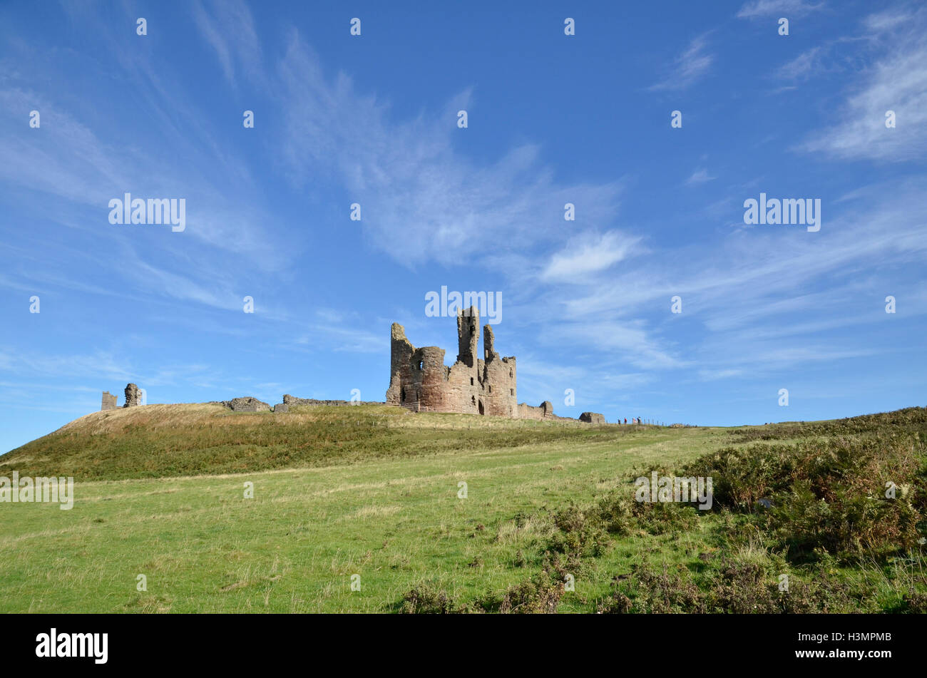 Dunstanburgh Castle on the Northumberland Coast - Stock Image