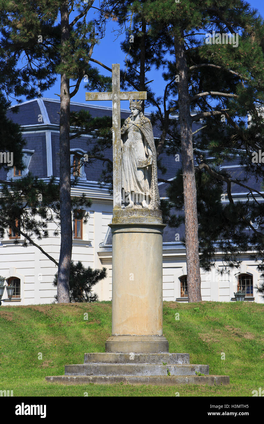 Baroque statue of Saint Helen holding a cross in the gardens of the Festetics Palace (1745) in Keszthely, Hungary Stock Photo