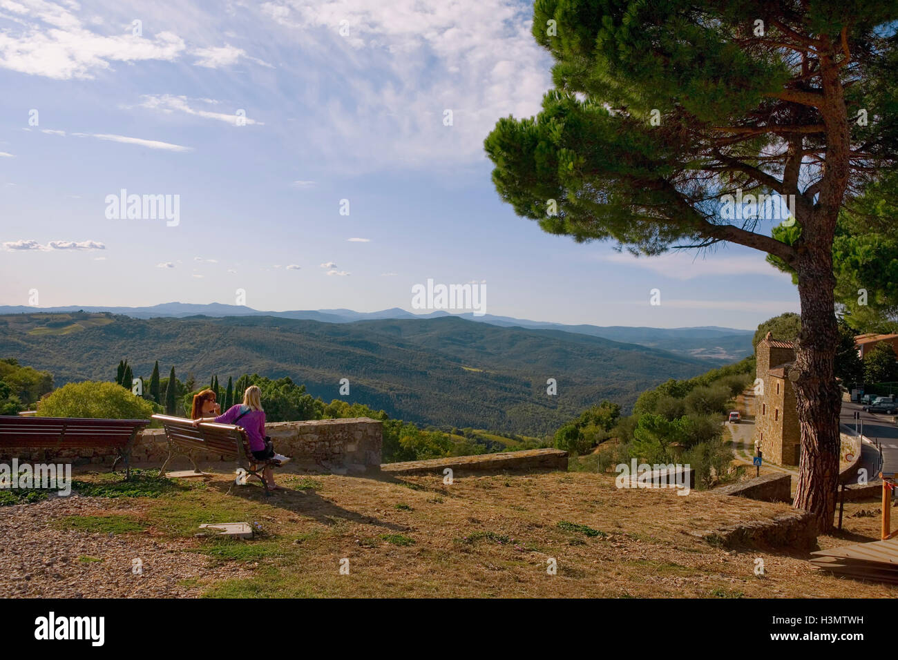 View across the Tuscan countryside of Val d'Orcia, from Viale della Libertà, Montalcino, Siena, Italy - Stock Image