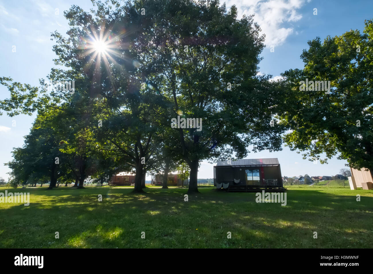 Mobile home in the gardens at Big Berry lifestyle glamping resort at Kolpa river Slovenia - Stock Image
