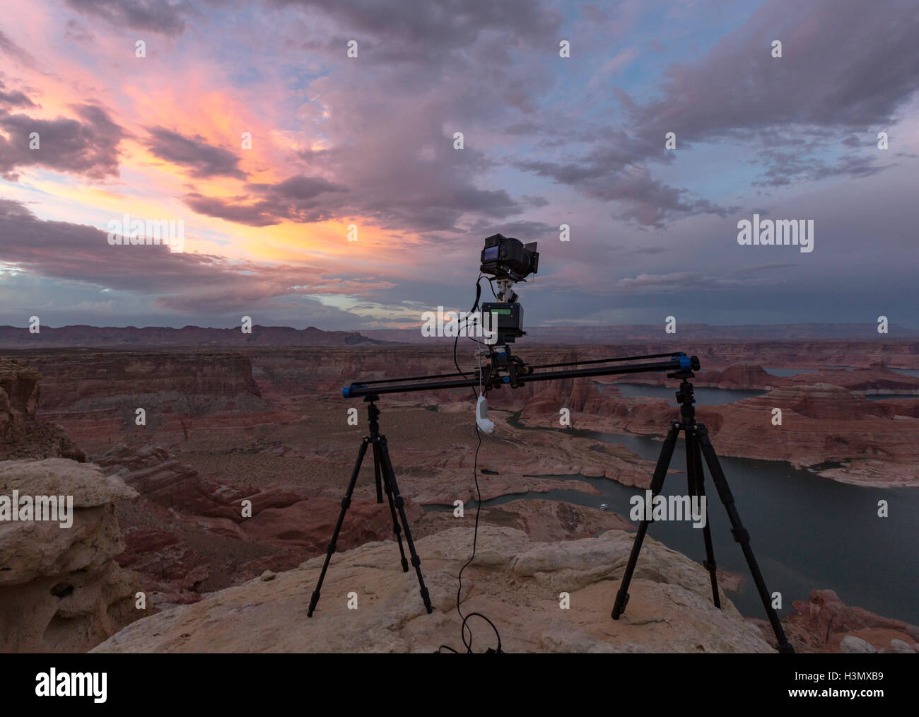 Camera on tripods photographing view of Lake Powell and canyons, Alstrom Point, Utah, USA - Stock Image